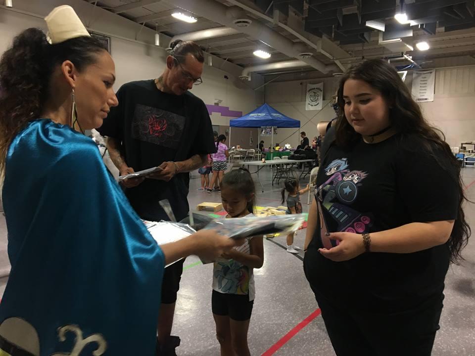 "Nurse Hope signs an autograph at the inaugural ""Indigi-Con.""."