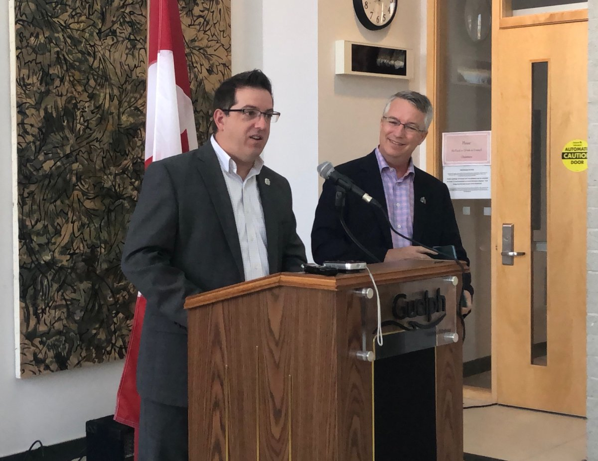 Guelph Mayor Cam Guthrie and MP Lloyd Longfield speak at a news conference in August 2018.