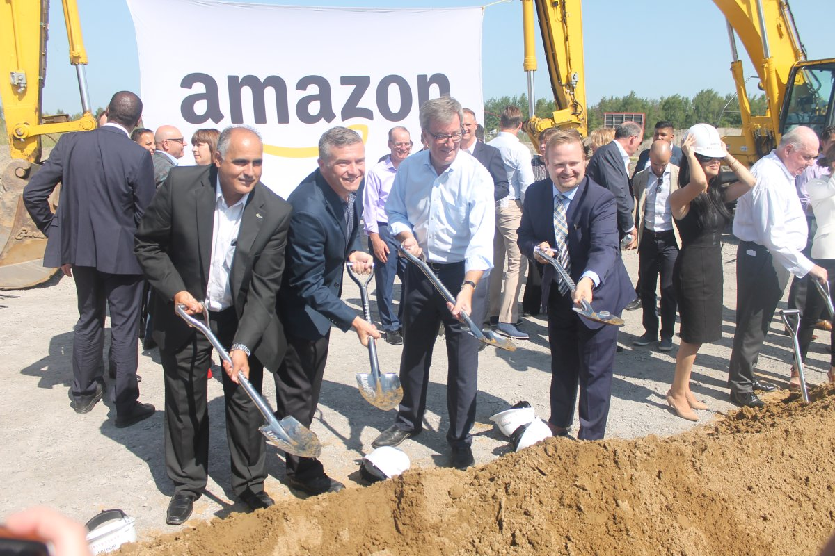 Ottawa Mayor Jim Watson along with city councillors George Darouze (left), Tim Tierney (second from left) and Stephen Blais (right) officially kick off the construction of the new Amazon fulfillment facility in the east end on Monday.