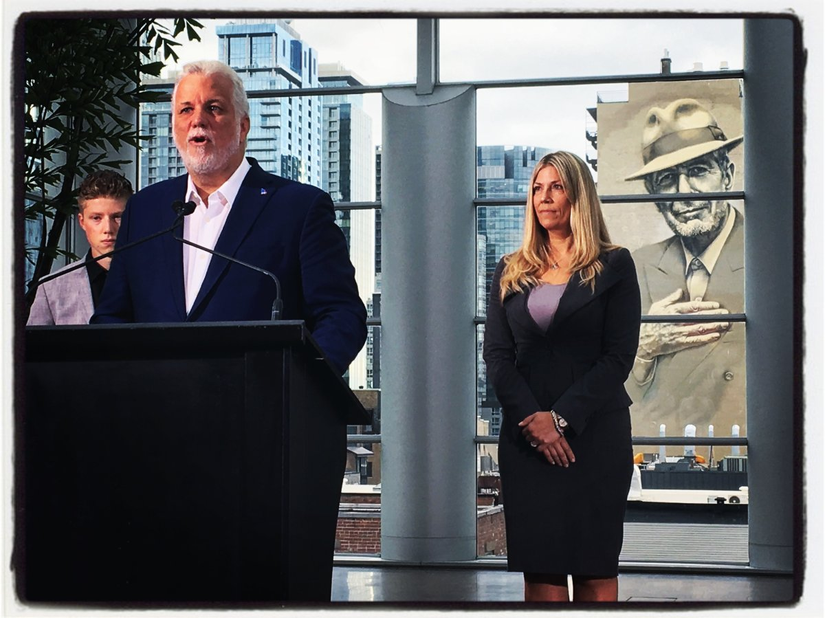 Premier Philippe Couillard, centre, introduces new Liberal party candidate for Westmount - St-Louis Jennifer Maccarone, left. (Global News / Phil Carpenter).
