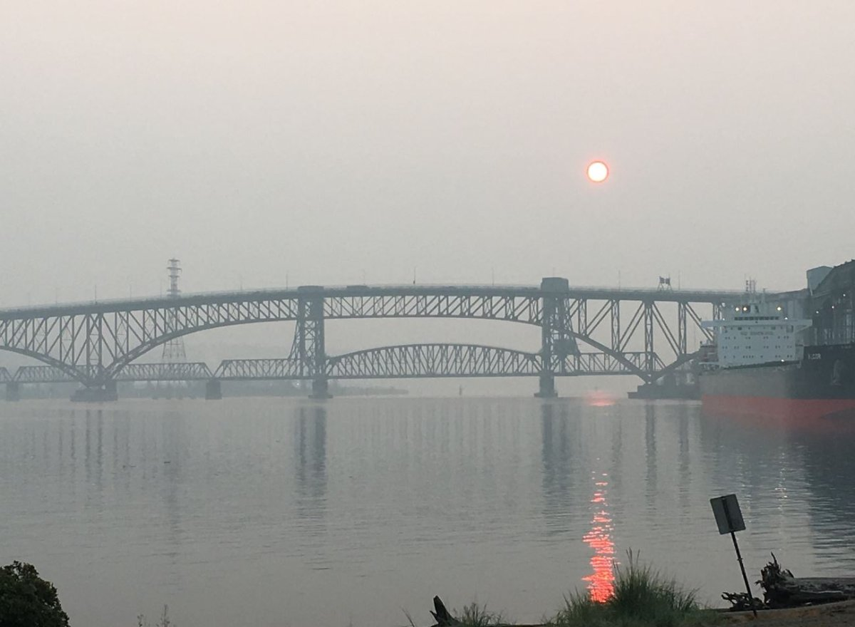 The smoky sunrise from New Brighton Park in Vancouver Tuesday morning.