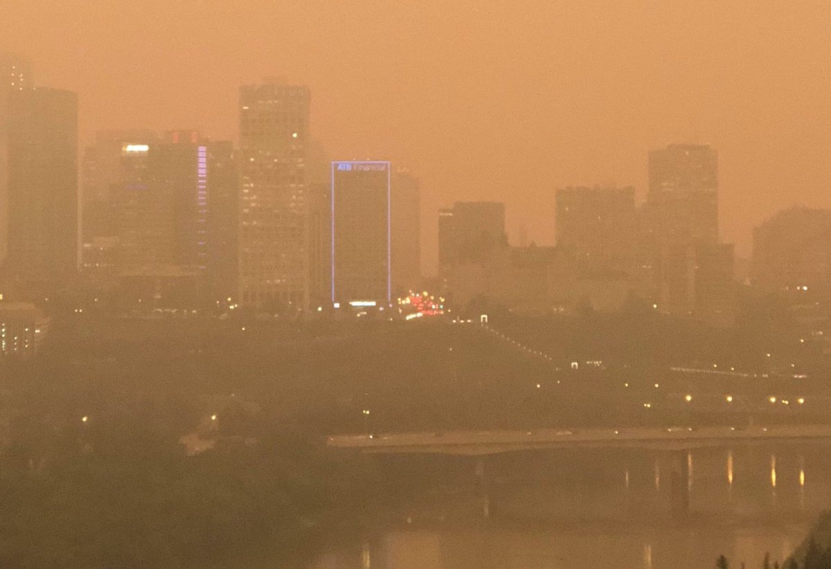 The sky in Edmonton was an  orange-brown hue Wednesday morning, due to thick smoke that had drifted east from the B.C. wildfires. August 15, 2018.