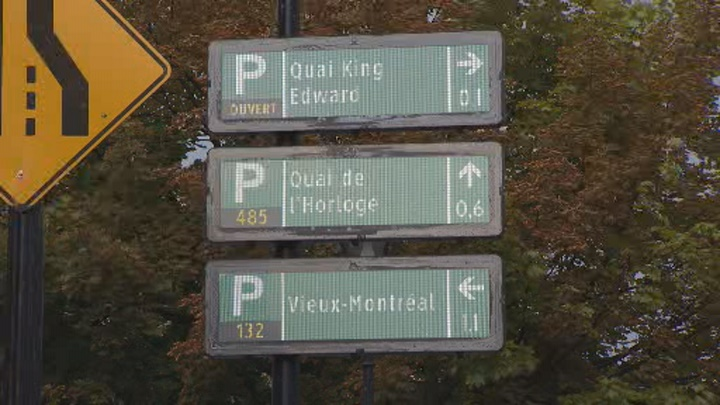 Digital parking signs show which parking lots are open and how many spots are available. Montreal, Aug. 29, 2018.