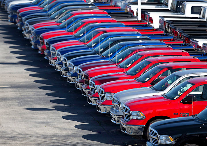 In this Jan. 5, 201, file photo, Ram pickup trucks are on display on the lot at Landmark Dodge Chrysler Jeep RAM in Morrow, Ga.