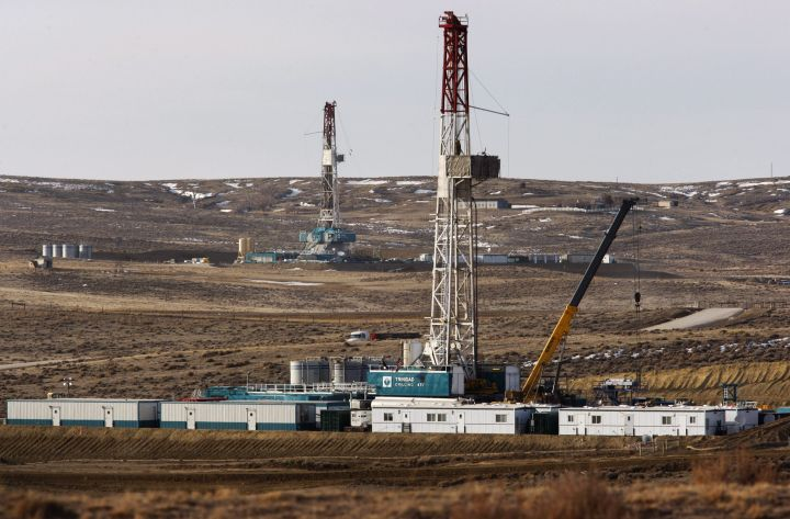 File photo of Trinidad Drilling rigs seen off of Way Highway 59 on March 5, 2013 just outside of Douglas, Wyo.