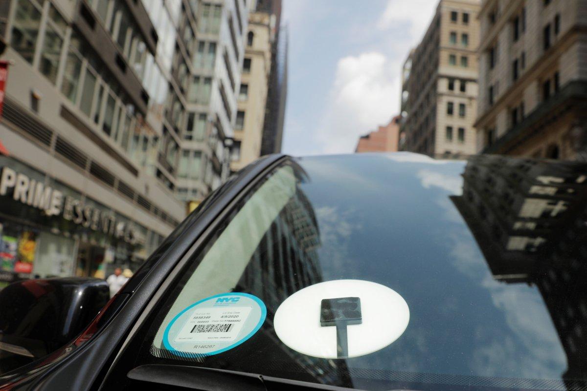 A car with an Uber logo.