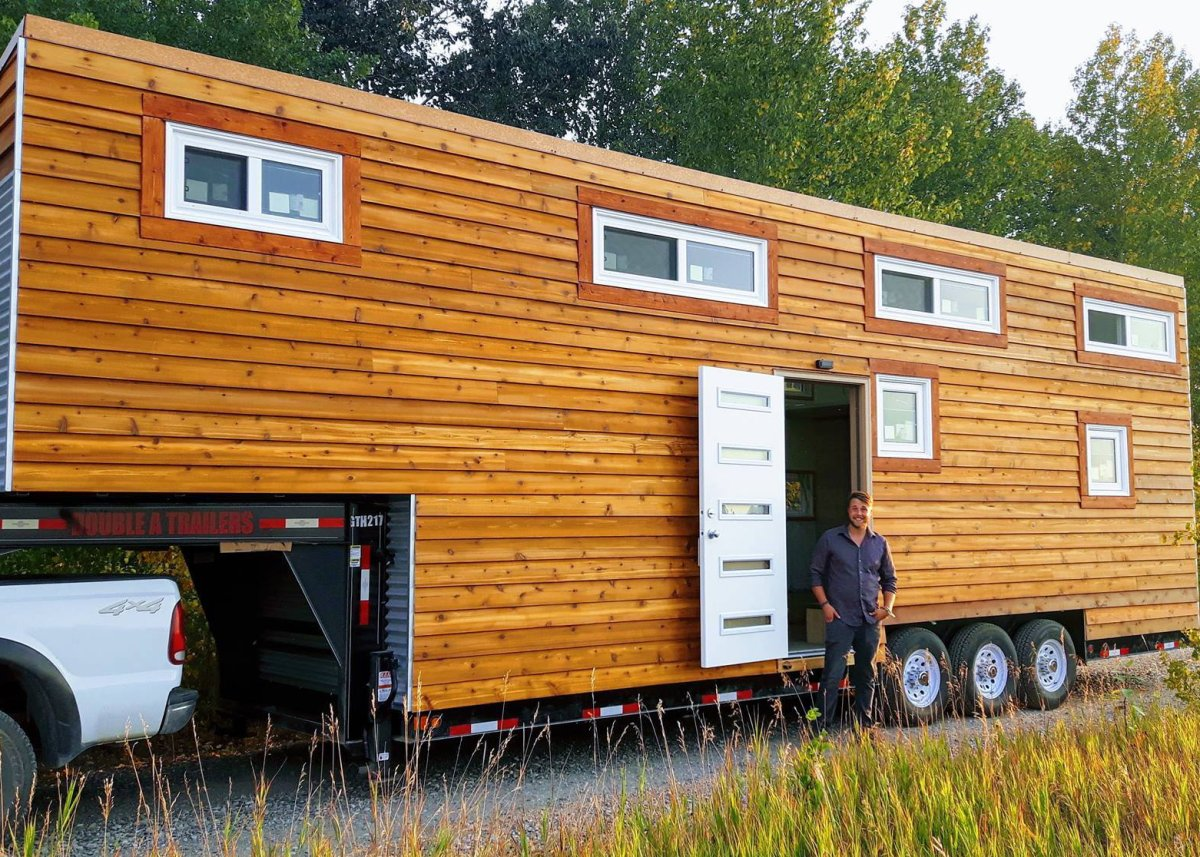 Vagabond Tiny Homes founder Thomas Grenier in front of his tiny show home.