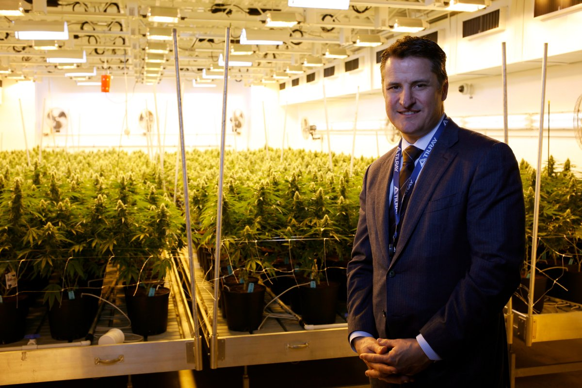 Tilray President Brendan Kennedy is photographed with some of the Tilray product line such as capsules, oils, and dried marijuana at head office in Nanaimo, B.C., on Thursday, November 29, 2017. THE CANADIAN PRESS/Chad Hipolito.