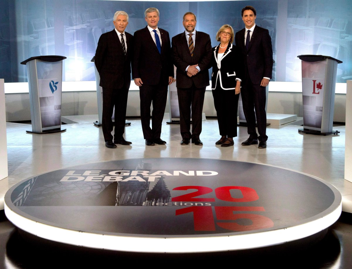 In this Sept. 24, 2015 file photo, Bloc Quebecois Leader Gilles Duceppe, from left to right, Conservative Leader Stephen Harper, NDP Leader Tom Mulcair, Green Party Leader Elizabeth May and Liberal Leader Justin Trudeau pose for photos before the French-language leaders' debate in Montreal.