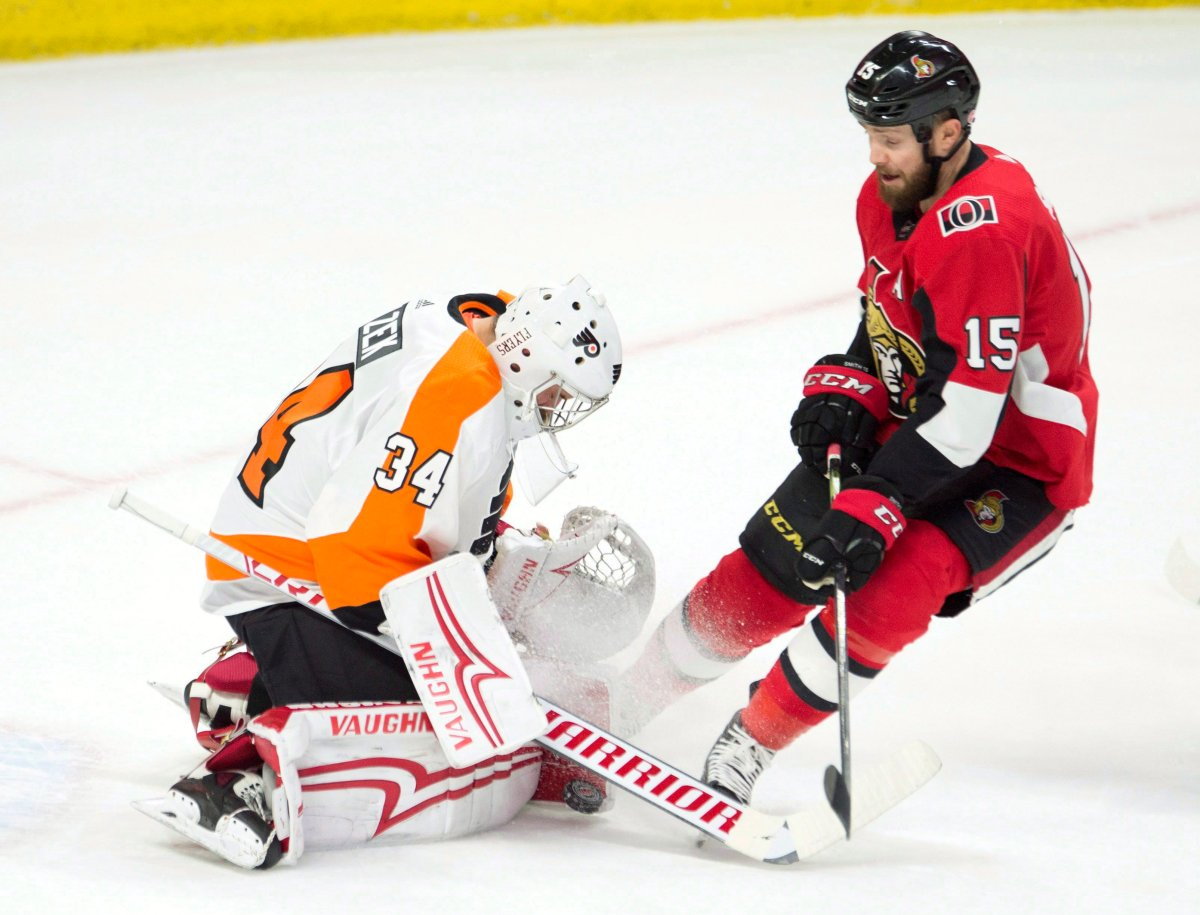 Ottawa Senators left wing Zack Smith pressures Philadelphia Flyers goaltender Petr Mrazek as he tries to control a shot during first period NHL action Saturday February 24, 2018 in Ottawa.