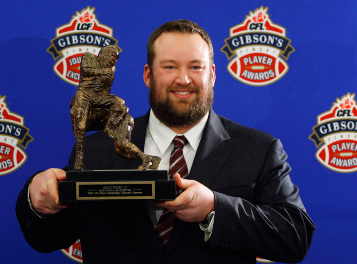 Scott Flory, of the Montreal Alouettes, holds his trophy for the CFL Most Outstanding Lineman during the 2009 Gibson's Finest Players Awards in Calgary on November 26, 2009. Punter Hank Ilesic, stalwart offensive lineman Scott Flory, late centre/linebacker Tom Hugo, defensive lineman Brent Johnson and defensive back Barron Miles will be inducted as players in the Canadian Football Hall of Fame.
