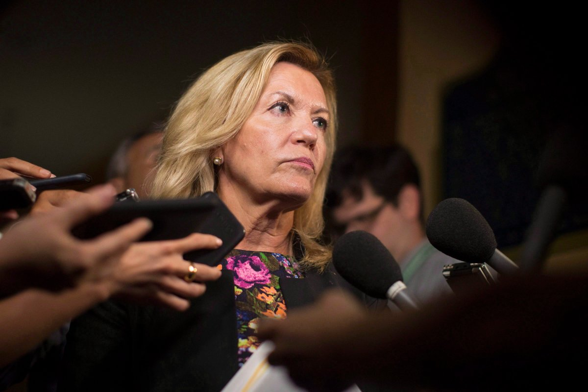 Ontario Deputy Premier Christine Elliott talks with journalists following Question Period at the Ontario Legislature in Toronto on Wednesday, August 1, 2018.