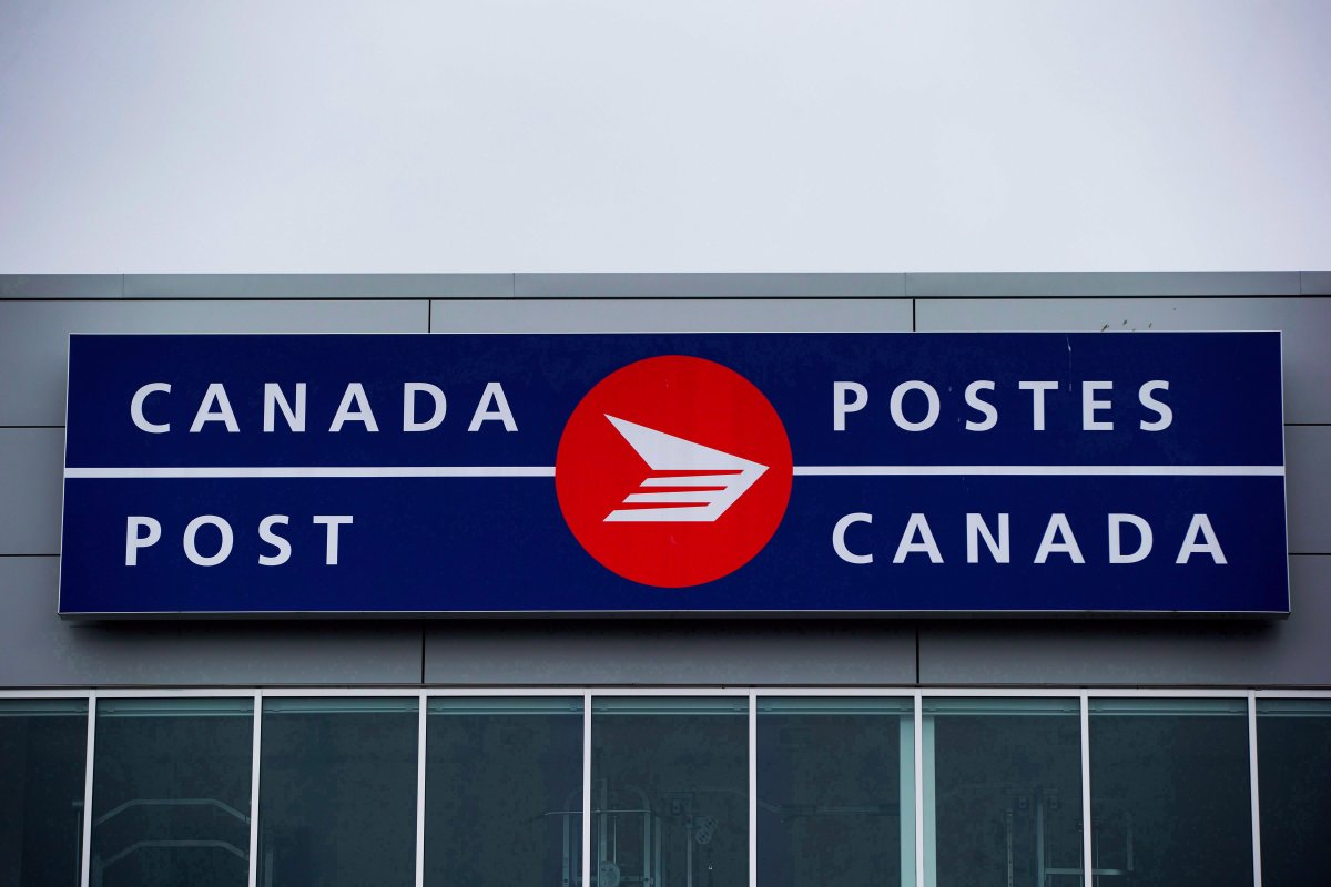 The Canada Post logo is seen on the outside the company's Pacific Processing Centre, in Richmond, B.C., on June 1, 2017.