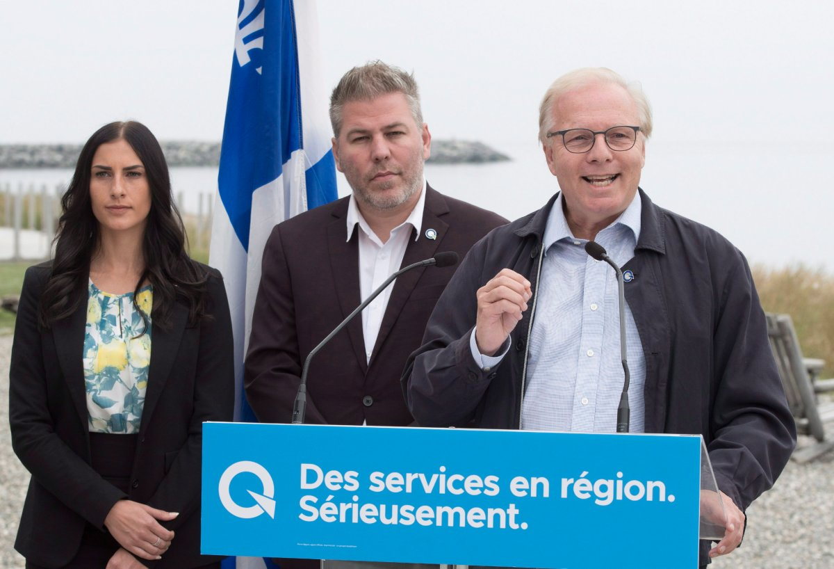 Parti Québécois Leader Jean-Francois Lisée, right, speaks at a news conference Monday, September 3, 2018 in Matane Que. Candidates Megane Perry-Melancon, left and Pascal Berubé, centre, look on.