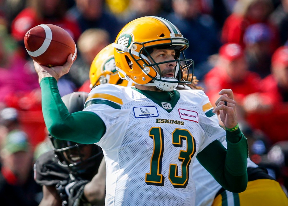 Edmonton Eskimos quarterback Mike Reilly throws the ball during second half CFL football action against the Calgary Stampeders in Calgary, Monday, Sept. 3, 2018.