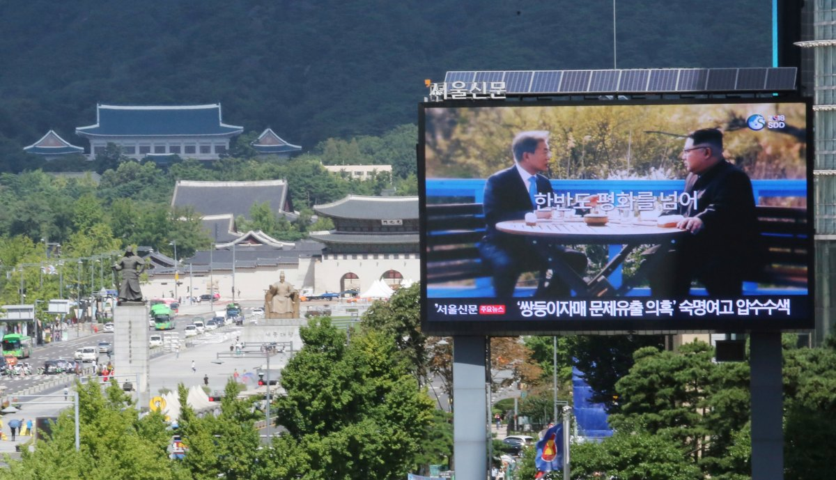 A TV screen shows a photo of South Korean President Moon Jae-in and North Korean leader Kim Jong UN, right, to advertise upcoming Seoul Defense Dialogue in Seoul, South Korea, Wednesday, Sept. 5, 2018.