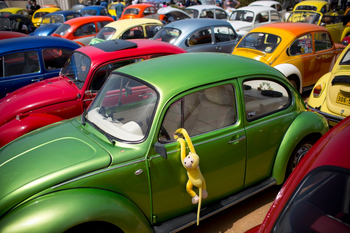 """FILE- In this April 21, 2017, file photo Volkswagen Beetles displayed during the annual gathering of the """"Beetle club"""" in Yakum, central Israel."""