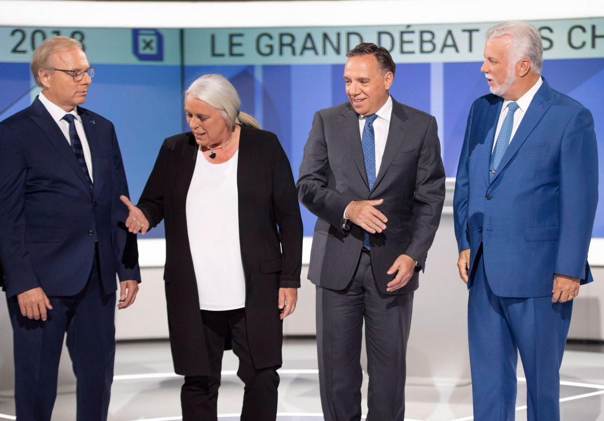 PQ leader Jean-Francois Lisee left, Quebec Solidaire leader Manon Masse , CAQ leader Francois Legault and Liberal leader Philippe Couillard , pose for photos before their debate Thursday, September 13, 2018 in Montreal, Que..