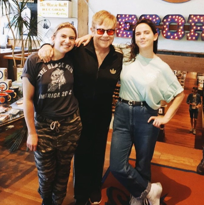 Elton John poses with Sonic Boom record store employees Lauren Mayer, left, and Ali Haberstroh in Toronto in this photo from Sonic Boom's twitter page.