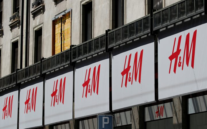 Logos of H&M are pictured on a store in Geneva, Switzerland, Aug.16, 2018.