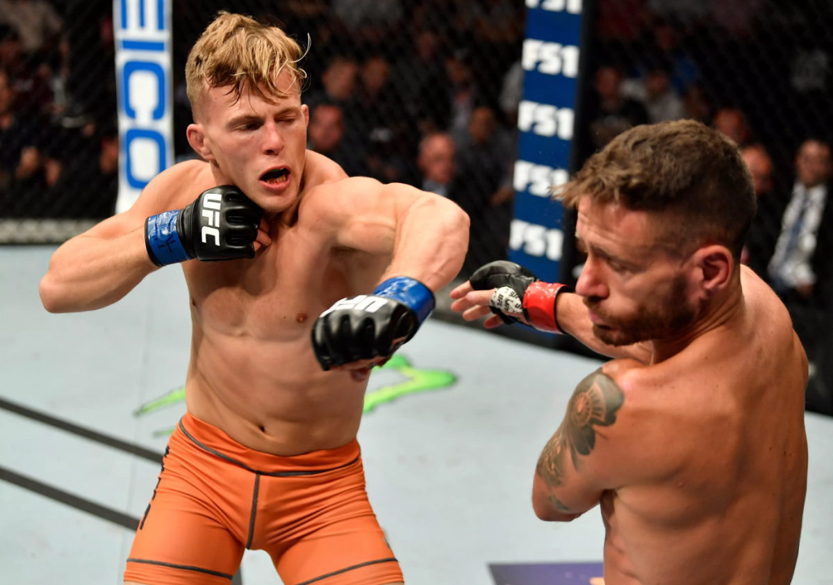 (L-R) Brad Katona of Canada punches Jay Cucciniello of Ireland in their featherweight bout during The Ultimate Fighter Finale event inside The Pearl concert theater at Palms Casino Resort on July 6, 2018 in Las Vegas, Nevada.