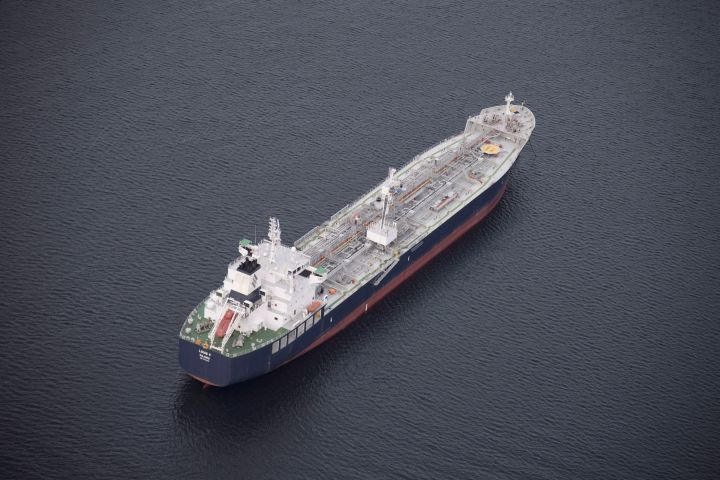 A tanker is anchored in Burrard Inlet just outside of Burnaby, B.C., on Friday, Nov. 25, 2016. The president of the company proposing the $16-billion Eagle Spirit Pipeline says his project could win regulatory endorsement if the federal government backs down on its plan to ban oil tanker traffic on the north coast of B.C.