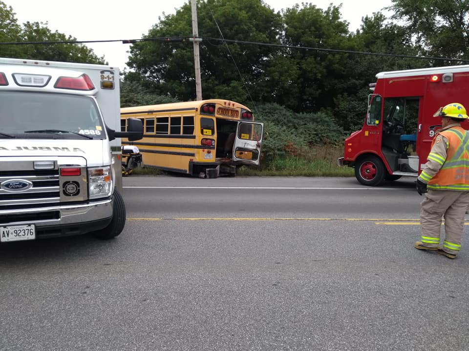 A damaged school bus is seen off to the side of Highway 34 after a collision with a tractor trailer on Wednesday morning.