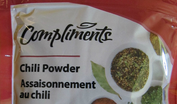 A package of Compliments chili powder.