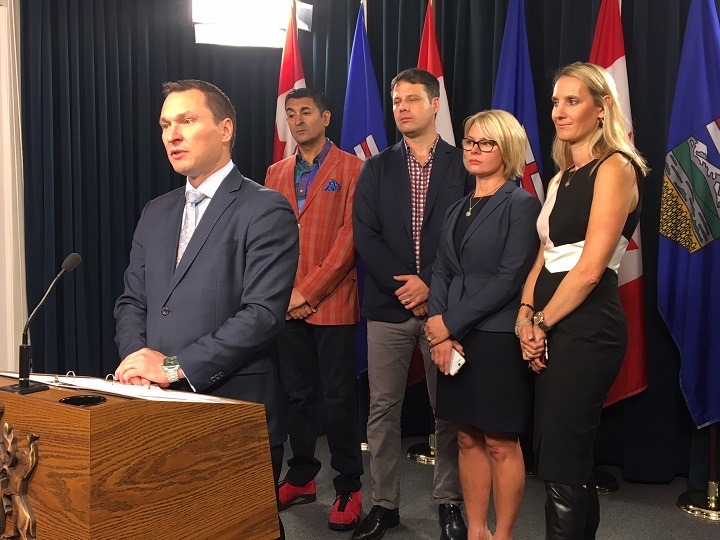 Minister of Economic Development and Trade Deron Bilous, Alberta business leaders Ashif Mawji and Cory Jannsen, JPC Corp. director Christy May and Connection Silicon Valley CEO Joanne Fedeyko at a news conference on Sept. 20, 2018.