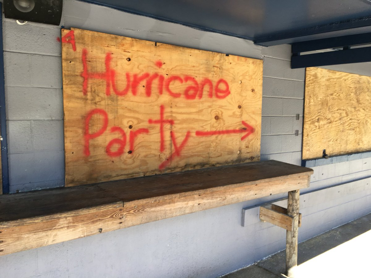 Instead of evacuating, some people are kicking back with beer and pizza.