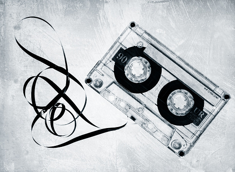 Grungy old cassette tape in black and white.