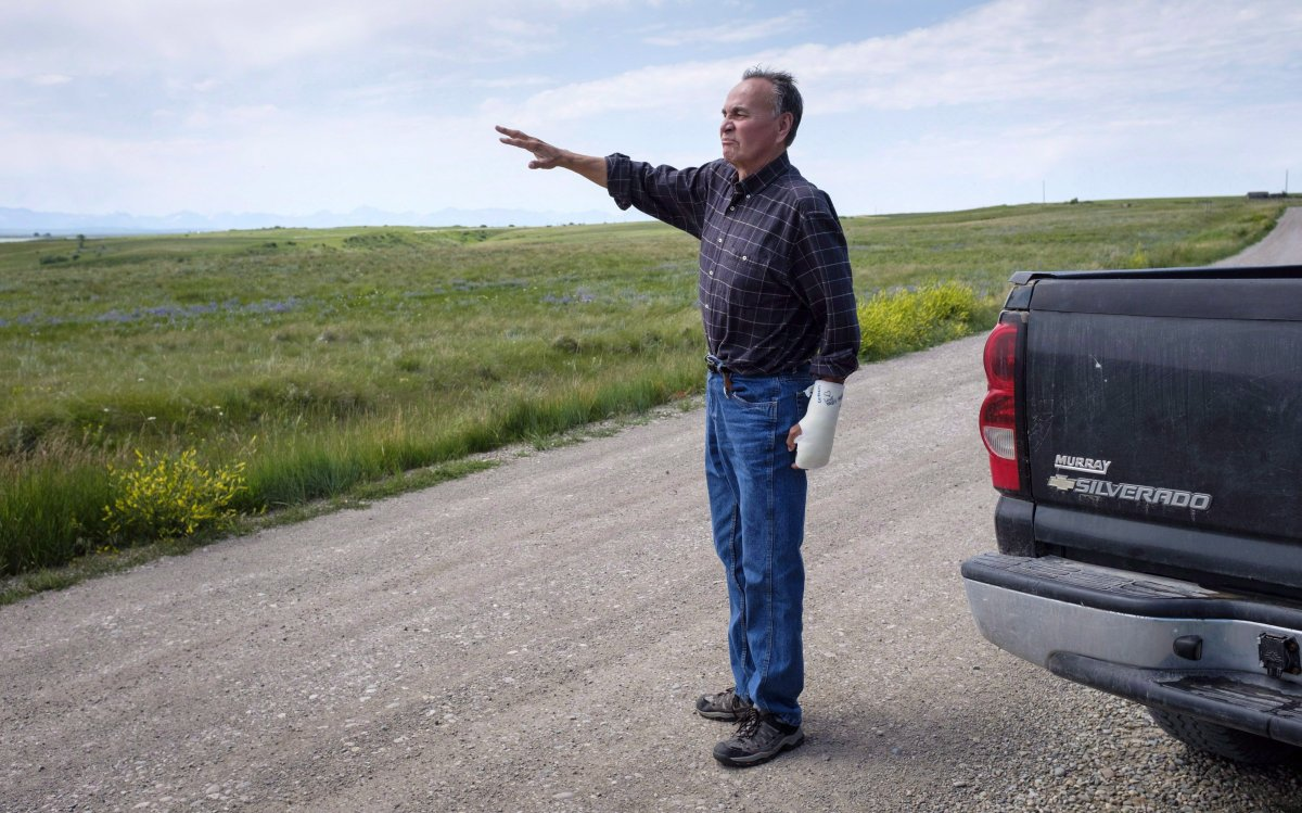 Former Blood Tribe Chief Harley Frank gestures from his truck on disputed land near his home near Spring Coulee, Alta. Thursday, July 5, 2018.