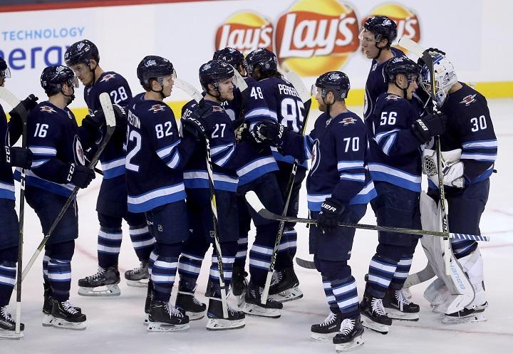 The Winnipeg Jets celebrate after defeating the Minnesota Wild during NHL preseason hockey in Winnipeg, Monday, September 17, 2018.