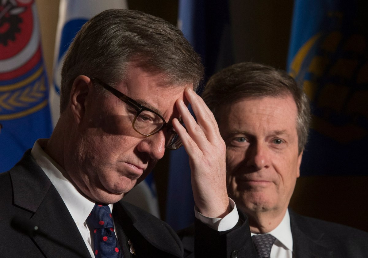 Ottawa Mayor Jim Watson and Toronto Mayor John Tory are seen during a news conference at the Federation of Canadian Municipalities meetings in Ottawa on Friday, January 20, 2017.