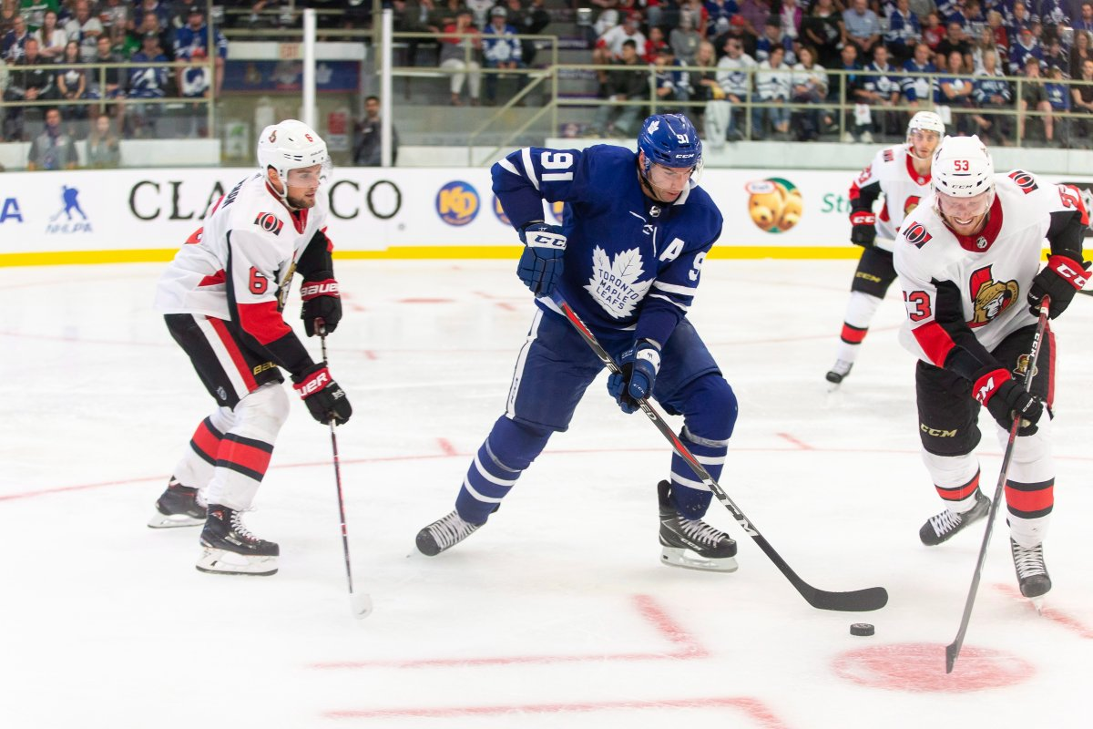 Toronto's John Tavares fights for the puck with Ottawa's Jack Rodewald during the second period of the NHL pre-season game between the Maple Leafs and the Senators in Lucan, Ont., Tuesday, Sept. 18, 2018.