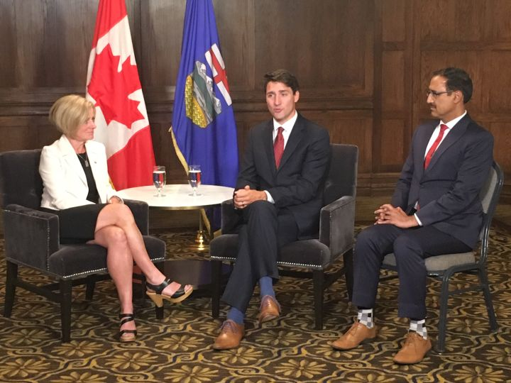 Alberta Premier Rachel Notley, Prime Minister Justin Trudeau and Natural Resources Minister Amarjeet Sohi meet in Edmonton, on Wednesday, Sept. 5, 2018.