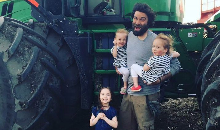 Organic farmer Travis Heide poses with his daughters, left to right, Adora, 9, and twins Audrey, and Gia, 6, near Melfort, Sask., in this undated handout photo.