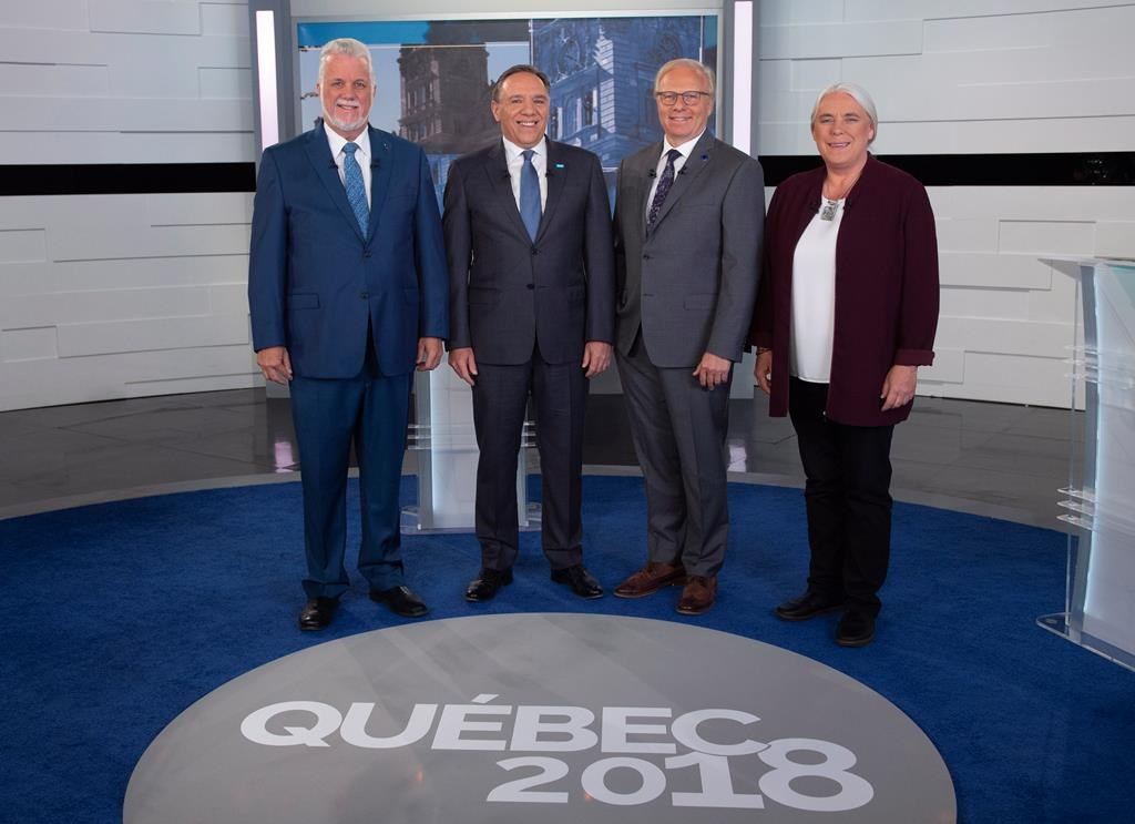 Liberal Leader Philippe Couillard, Coalition Avenir Quebec Leader Francois Legault, PQ Leader Jean-Francois Lisee and Quebec Solidaire Leader Manon Masse, left to right, stand for a photo prior to Face a Face Quebec 2018, the third Quebec elections leaders debate in Montreal, on Thursday, Sept. 20, 2018.