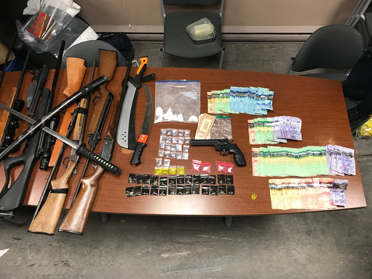 RCMP seize drugs, weapons and cash from a home in Crane River, Man. Charges are pending for three people.