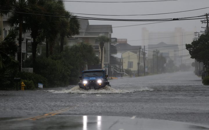 A vehicle navigates a flooded Ocean Boulevard during Hurricane Florence in North Myrtle Beach, South Carolina, U.S. September 14, 2018.