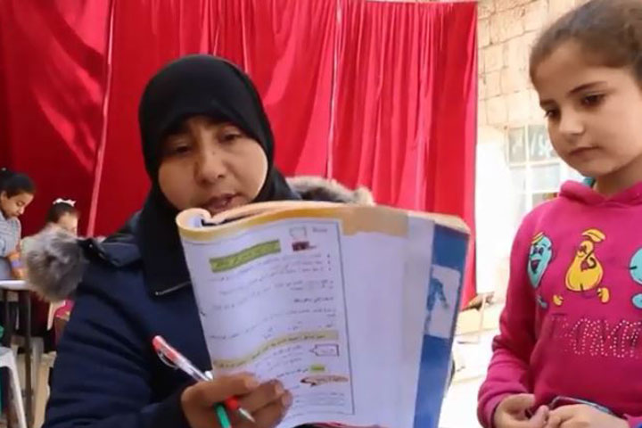 A screenshot from Nasaem Souria TV's report on children's education in Syria.