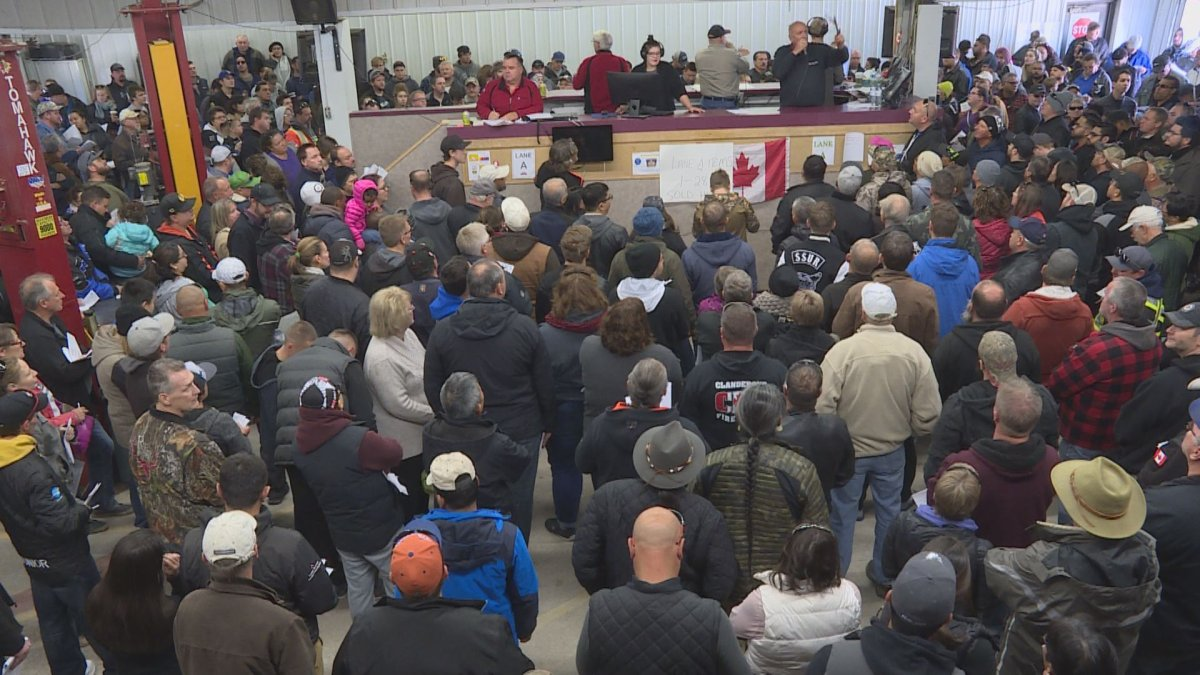 In this file photo, bargain hunters flood a Headingley auction house for the police unclaimed goods auction.