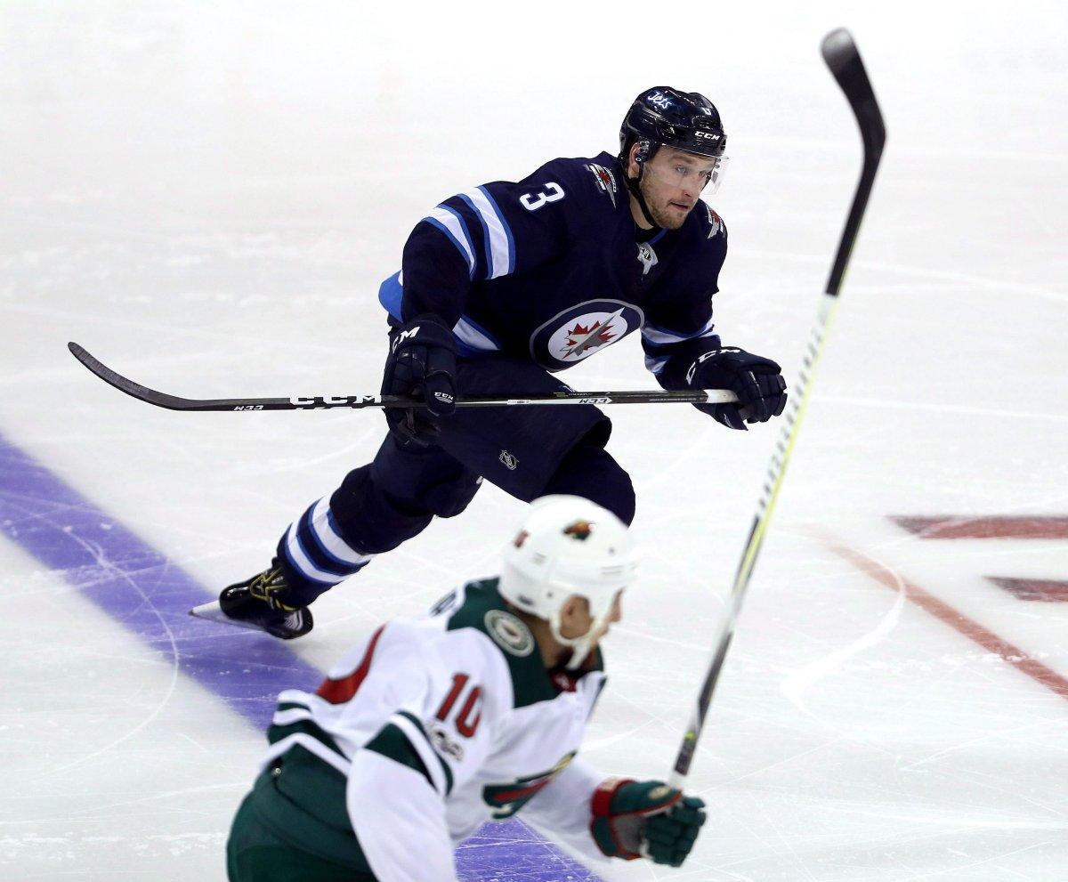 Winnipeg Jets defenceman Tucker Poolman (3) skates up ice while playing against the Minnesota Wild during third period NHL preseason hockey action in Winnipeg, Monday, September 18, 2017. THE CANADIAN PRESS/Trevor Hagan.