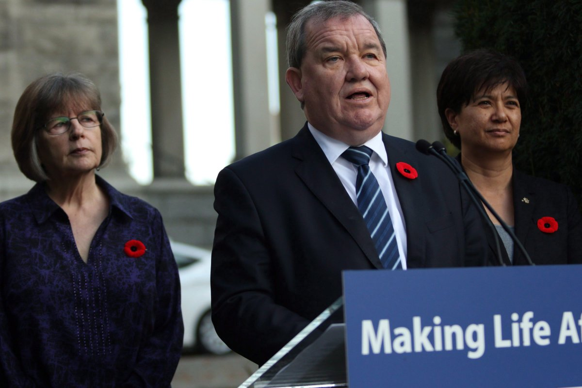 Minister of Social Development and Poverty Reduction Shane Simpson is joined by UNBC chair Dawn Hemingway, (left), and Parliamentary Secretary and co-chair Mable Elmore as they discuss details of an advisory forum on poverty reduction during a press conference from the Rose Garden at Legislature in Victoria, B.C., on Monday, Oct. 30, 2017.