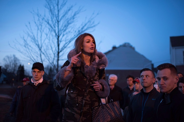 Faith Goldy who was supposed to speak at Wilfrid Laurier University but was interrupted by a fire alarm speaks outside the university on Tuesday, March 20, 2018.