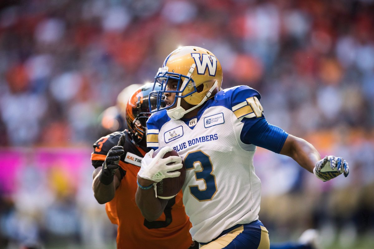 Winnipeg Blue Bombers' Kevin Fogg, front, runs the ball past B.C. Lions' Ricky Collins Jr. after making an interception in the end zone during the first half of a CFL football game in Vancouver on Saturday July 14, 2018.