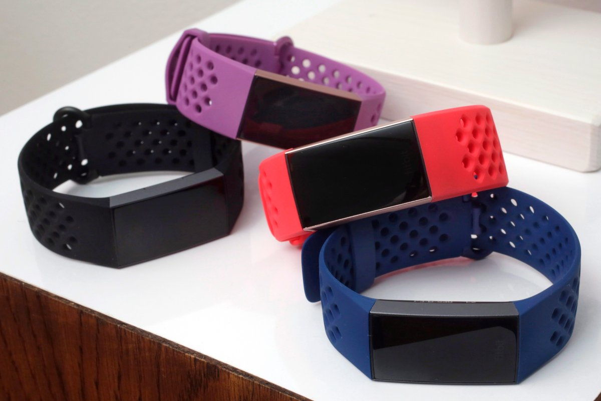 In this Aug. 16, 2018 file  photo, Fitbit Charge 3 fitness trackers with sport bands are displayed in New York.