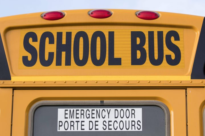 Police have charged a driver after she reportedly failed to stop for a school bus near Tillsonburg, Ont.