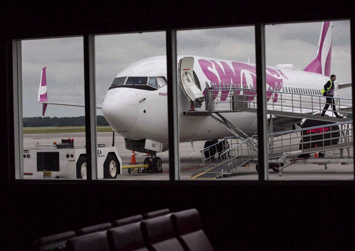 A Swoop Airlines Boeing 737-800 is on display during a media event, June 19, 2018 at John C. Munro International Airport in Hamilton, Ont.