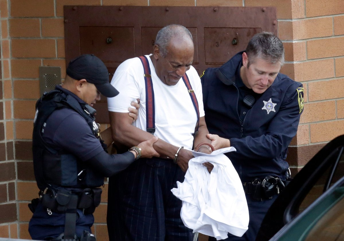 In this Sept. 25, 2018 file photo, Bill Cosby is escorted out of the Montgomery County Correctional Facility in Eagleville, Pa., following his sentencing.
